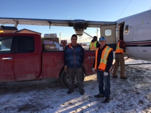Mark Akeeagok (right) along with hired help Kyle (left) who goes to Umimmak High School offloading the first charter in Grise Fiord.